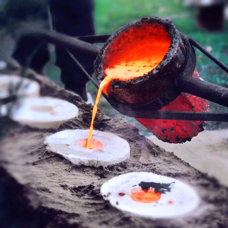 Liquid bronze at 1200°C is poured into the dried and empty casting mold