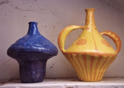 Design and make a clay vessel using kiln clay. The shape and decoration of the vessel should exhibit the influence of abstract art.
